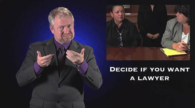 A man is signing is ASL. In the background is a litigant and an attorney with the following text overlaid: Decide if You Want a Lawyer