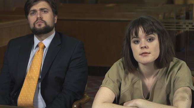 A juvenile victim of sex trafficking sitting at a table with her attorney