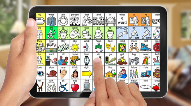 A person is holding an Augmentative and Alternative Communicatiolns device