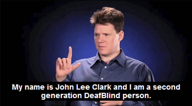 A young man is signing and the captioning says: My name is John Lee Clark and I am a second generation DeafBlind person.