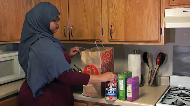 Photo of a Somali woman in a kitchen unloading groceries