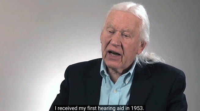 """Photo of Dr. Sam Trychin talking about his life. A caption reads """"I received my first hearing aid in 1953"""""""